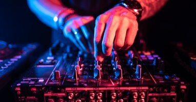 close_up_dj_hands_controlling_music_table_night_club